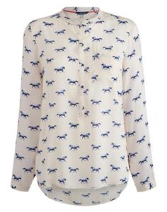 Joules Women's Collarless Shirt, Creme Horse.                     Soft, lightweight and versatile. The drapey fabric of this easy-to-wear pop-over shirt will make sure comfortable, laidback style is never far away. We've updated this old favourite to include a curved hem, granddad collar and a cleaner silhouette.