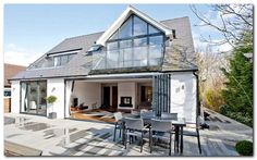 Love the window dormers and indoor outdoor flow onto deck Simple Loft Conversion Ideas for Dormer