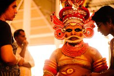 A Theyyam dancer gives an answer to a visitor #photos #photography #artiagarwal #travel