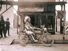 An Indian sitting on an Indian Motorcycle. (1918)