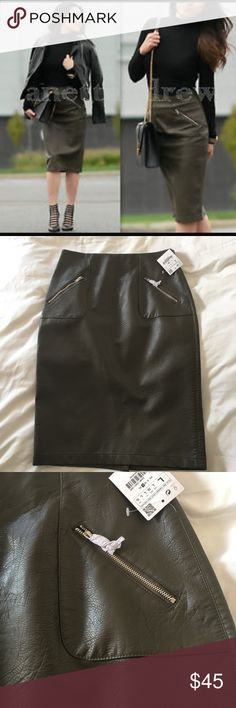 ZARA Faux Leather skirt ( NEW W/Tags) LARGE ZARA faux GREEN Leather skirt- LARGE. New with Tags.  MEASUREMENTS  Waist- 14.5 inches  Hip- 19.5 inches  Length- 26 inches Zara Skirts Pencil