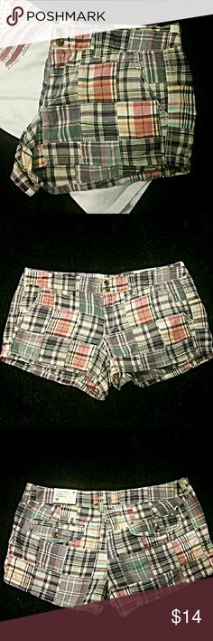 Fun American Eagle Outfitters NWT Plaid Shorts Cute American Eagle Outfitters plaid shorts. Many colors come together to make up this beautiful plaid. Double button and zip fly closure. Five pocket styling, two large and one mini pocket in front, two flap pockets with button closures in back. Belt loops. 100% cotton. American Eagle Outfitters Shorts