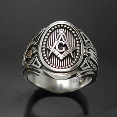 Made entirely in the U.S.A.  Ring Details~  Unlike anything you have ever seen this new and exciting cigar band style will be a standout addition to any collection.  All creations are custom designed, hand cast with solid sterling silver, and individually polished.  THIS IS NOT MASS PRODUCED.   * Solid back * Weighs approx. 18 grams.  * The top has a raised emblem with a lowered background to enhance detailing.  * Black oxidized background to enhance masonic symbols.  * Each side has the…