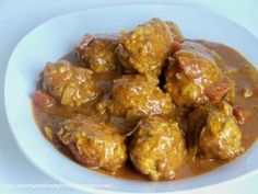 SAUCY MEATBALLS IN THE SLOW COOKER