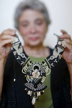"""Jewelry artist Barbara Natoli Witt holds a piece called, """"Pre-Columbian Tucan Made of Shell,"""" on Tuesday, July 5, 2011 in her Oakland, Calif..."""