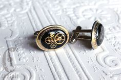 Steampunk Vintage Golden 1960s or 1970s Avon Brand Oval Goldtone Oval Shaped Cufflinks with Black Onyx and Antique Brass Watch Cogs