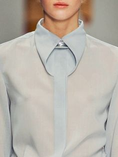 issey miyake folded collar detail - an unusual little fashion feature that makes this otherwise simple shirt, quite interesting