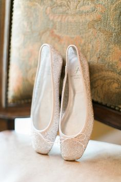 Our zoe ballet flats are perfect for the low key bride   Photography: Jacqui Cole Photography - http://www.stylemepretty.com/portfolio/jacqui-cole-photography Bride's Shoes: Adrianna Papell - http://www.stylemepretty.com/portfolio/adrianna-papell-2   Read More on SMP: http://www.stylemepretty.com/2015/07/31/elegant-pastel-safety-harbor-spa-wedding/