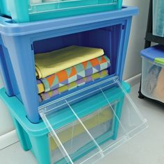 """These storage bins are """"totes"""" perfect for beach/pool towels! Best part? Access doors allow you to grab items at the bottom of the stack."""