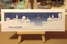 Bethlehem. Designed in Serif DrawPlus and cut on Silhouette Cameo. Distress inked sky with memory box star.