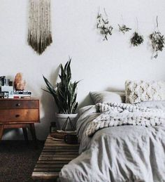 Mixing natural colors and textures with geometric shapes and plants create the perfect bohemian bedroom