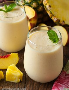 Smoothie Recipes A light and delicious Fresh Pineapple Peach Smoothie made with non-fat Greek Yogurt and milk. - A light and delicious fresh pineapple peach smoothie made with non-fat Greek Yogurt and milk. Peach Smoothie Recipes, Smoothie Fruit, Smoothie Drinks, Healthy Smoothies, Healthy Drinks, Healthy Snacks, Healthy Recipes, Honeydew Melon, Drink Recipes