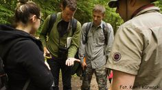 Jason Hoeksema, associate professor of biology (second from left), shows a specimen of rare fungi to students in an ancient forrest in Poland. | University of Mississippi College of Liberal Arts