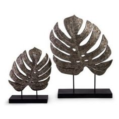 IMAX Silver Antiqued Leaves - Set of 2 Transitional, tribal design silver set of two leaves on stands in graduated sizes. Material: Polyresin, Stone Powder, Iron Specification This item includes: Silver Antiqued Leaves - Set of 2 x x Decorative Objects, Decorative Accessories, Decorative Bowls, Decorative Accents, Garden Accessories, Leaf Table, Tropical Leaves, Boutique, Joss And Main