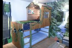 For a forest look in your childs bedroom, go for fake vines and wall mural to get this effect. Photo: found on pinterest