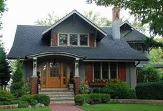 Craftsman-style with arched entryway