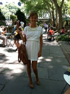 Staying cool in a white dress from BCBG with matching accessories.