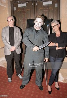 John Carpenter, an actor dressed as 'Halloween' character Michael Myers, and Jamie Lee Curtis attend the American Cinematheque Film Series' Beyond Fest - 'Halloween' Screening And Q