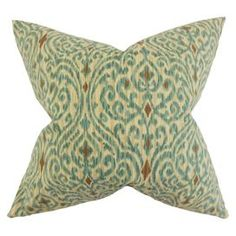 Featuring an ikat pattern, pair this striking cotton cushion with a neutral palette and matching hued artwork for contemporary appeal.   Product: CushionConstruction Material: CottonColour: Green and brownFeatures:  Reversible pillow with same fabric on both sidesIncludes a hidden zipper for easy cover removal and cleaningComes standard with a high-fiber polyester pillow insert All four sides have a clean knife-edge finishDimensions: 46 cm x 46 cm Cleaning and Care: Dry cleaning ...