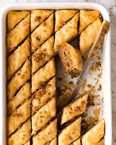 Nadire Atas On Baklava Desserts Layers upon layers of flaky buttery pastry with crushed nuts soaked in a honey lemon syrup. The iconic Baklava is astonishingly straight forward to make! Smores Dessert, Brownie Desserts, Arabic Dessert, Arabic Food, Arabic Sweets, Pastry Recipes, Dessert Recipes, Cooking Recipes, Cake Mug
