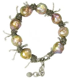 Natural Kasumi Pearls wrapped in sterling. nanfusco.com