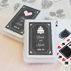 Chalkboard Playing Cards Wedding Favor includes a standard deck of cards.  Each deck of cards is printed on white glossy stock with traditional red, black and white artwork. It is then packaged in a translucent box and a personalized label.