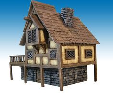 The defensive position is now ready to be painted, while some other buildings are taking shape Enjoy Fantasy Town, Fantasy House, Fantasy Map, Medieval Houses, Medieval Town, Brighton City, Wargaming Terrain, Gnome House, Fantasy Places