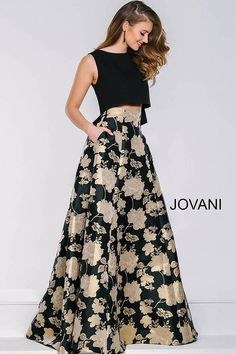 Floral print two piece dress features a black sleeveless top and a floral floor length skirt with pockets in the front and a hidden zipper in the back.