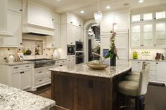 Kitchen - gorgeous - beautiful white cabinets with black hardware and Alaska White granite countertop - cabinet BM White Dove and wall is Grant Beige - beautiful Brazilian Cherry floor | Martha O'Hara Interiors and built by Stonewood, LLC
