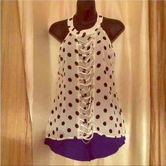 Top and bottom set Whit top with siver accessories.  Blue shorts Other