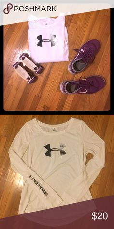 Long sleeved Under Armour tee White long sleeved 100% cotton UA tee. Torso has more room than arms/shoulders--I'm broad shouldered so only have worn this a few times. No stains or tears! Under Armour Tops Tees - Long Sleeve