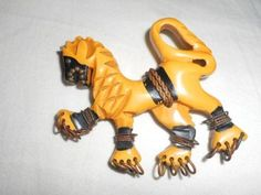 "vintage 1930s carved cream Bakelite Heraldic Lion design brooch pin with painted black decoration and applied brass dots and rings and fabric cord - measures 2-1/2"" by 2-1/2"" - auction starting at $400 on eBay"