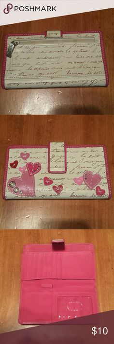 FOSSIL Pink Heart Checkbook Style SL8187, pink heart cutouts with metal accents on a cream background, 8 card slots, 1 ID slot, 6 compartments inside for checkbook/cash/movie tickets/whatever, sling for pen/pencil, 1 zippered compartment outside, leather exterior, urethane interior, absolutely perfect condition. Fossil Bags Wallets