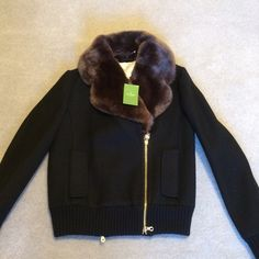 KATE SPADE Black Jacket Faux Fur  Great Jacket with Faux Fur Black with Tags. Brass Zippers . Purchased at Store in Chicago!                    NO TRADING NO HOLDS, PLEASE DON'T ASK. LOWBALL OFFERS WILL BE IGNORED.  kate spade Jackets & Coats