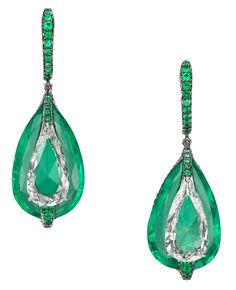 Emeralds and diamonds appear to have merged into one, thanks to the technically demanding Art of Inlay technique in which absolutely no metal is visible in this pair of Boghossian Jewels drop earrings.