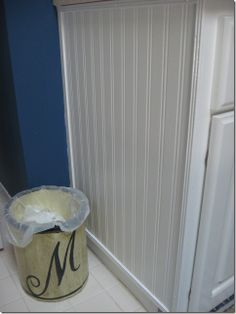 Beadboard Wallpaper Project - Southern Hospitality. Using beadboard wallpaper to jazz up cabinets. So cool!