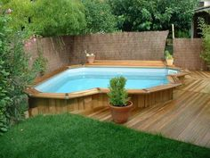 Piscine d'angle en bois hors sol Bluewood© Bluewood