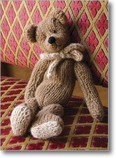 Tiny sweet old fashioned teddy. Originally published in  Interweave Knits Holiday Gifts, 2007