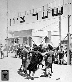 New immigrants dancing ,Hora' at Zions Gate in Tel Aviv Harbour, 1939.  Photo House Pri-Or.