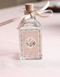 Pretty bottle with pink roses... for the bathroom or dressing table.