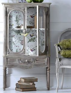 Silver armoire with delicate wallpaper back