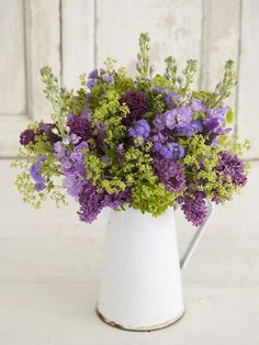 Lilac Flower Arrangement fresh lilacs and lavender alongside green lady's mantle or eucalyptus in a vintage pitcher. Description from pinterest.com. I searched for this on bing.com/images