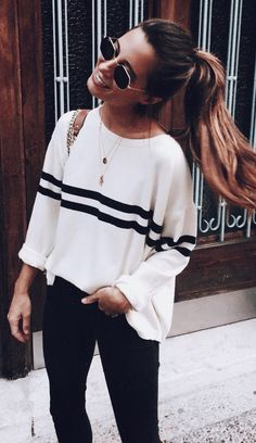 I love the basic colors, and simple stripe in the sweater.  Not sure the cut would work for me, but I'd love to try something like this.