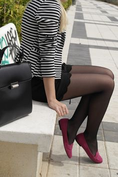 Striped black & white jacket with wavy cut shorts, black pantyhose and flat dark pink shoes
