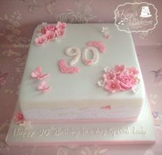 Powder blue and pink flowered 90th birthday cake By Kaye's Backroom Cakery