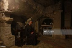 A Franciscan monk prays inside the cave at the Church of the Nativity in the biblical West Bank city of Bethlehem, believed to be the birthplace of Jesus Christ, on December 24, 2012. Thousands of Palestinians and tourists were flocking to Bethlehem to mark Christmas at the site where many believe Jesus Christ was born.