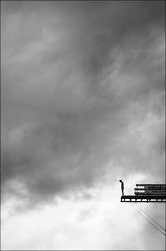 Standing on the precipice of realization - amidst the chaos of existence. The choices: to remain on the platform of reason or to plummet straight into uncharted territories to risk heaven or hell for a chance at immortality.