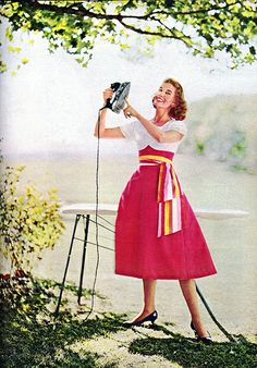 1957 - Ouch!  I always do my ironing outside.  But where the hell is the electric outlet for this freakin' iron????