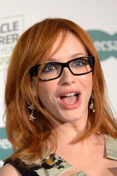 Christina Hendricks dons a pair of black rimmed glasses as she helps to launch the search for Australia's Most Stylish Spectacle Wearer for Specsavers.