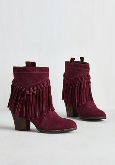 When strutting about in this lovely leather pair, it's totally impossible to resist busting a move or two! Rich burgundy suede pairs perfectly with outfits aplenty, and complete with a stacked block heel, these fringed booties are ready to shake anytime or place with unparalleled pizzazz.